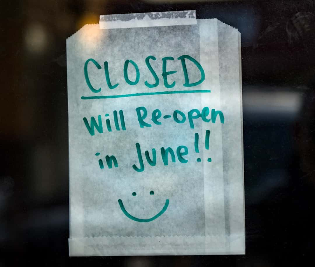sign on window saying closed until June